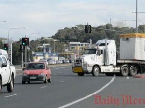 Trucks manoeuvre new merging lane on Bruce Hwy