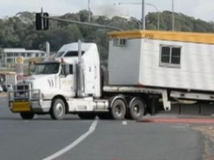 Trucks manoeuvre new merging lane on Bruce Hwy