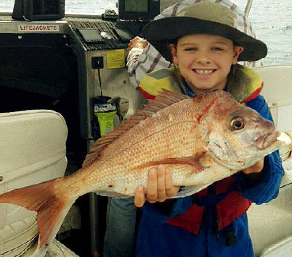 HAPPY TIMES: Thomas Branigan, from Kholo, caught his snapper off Moreton Island.