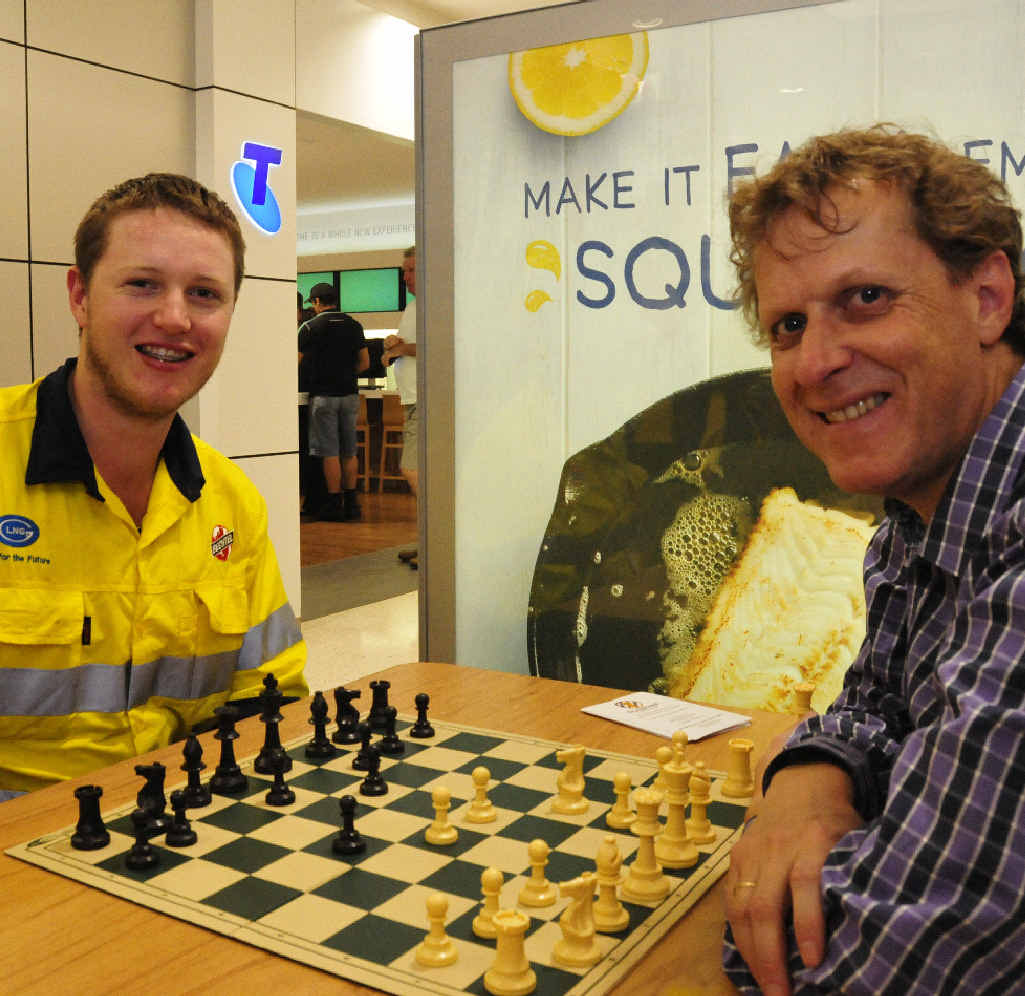 Dan Beyers takes on international chess star Gary Lane at Stockland ahead of the Queensland Open Chess Tournament in Gladstone this weekend.