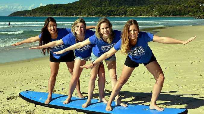 HANGING FOUR: Ultimate Internship winner Angeliqa Jonsson (right) and friends (from left) Angi Kim, Samui Reid and Emilia Freijd on Main Beach, Noosa.