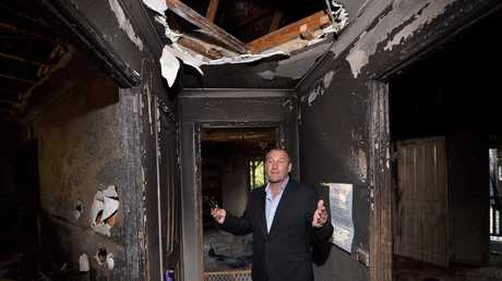 DAMAGE CONTROL: Agent Steve Venn in the house that will go to auction after being severely damaged by fire.