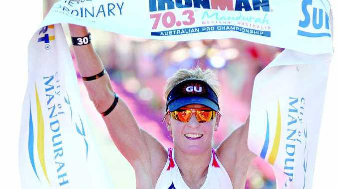 ONE OF OUR BEST: Noosa's Melissa Hauschildt celebrates at the finishing line after taking out the 70.3 Ironman Triathlon in Mandurah, Western Australia, last November.
