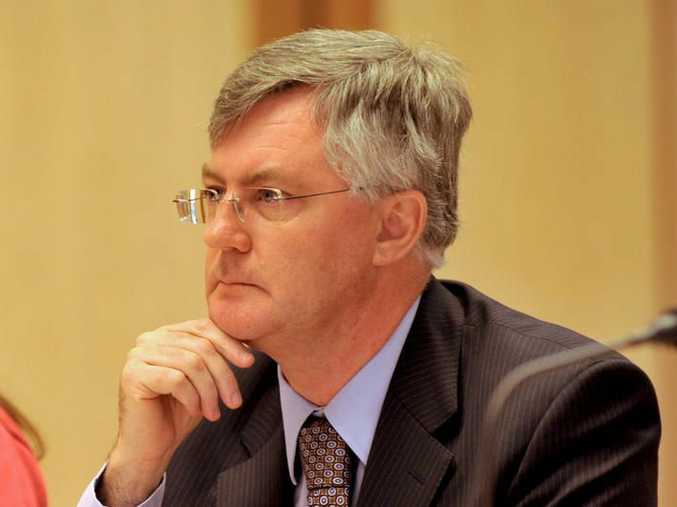 The new secretary of Treasury Dr Martin Parkinson speaking at the carbon tax inquiry in Canberra, Thursday, March 24, 2011. Dr Parkinson replaced long standing secretary Dr Ken Henry who has retired.