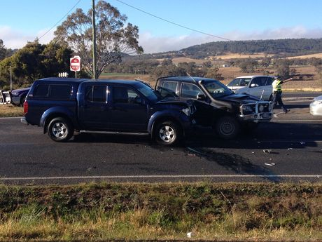 Two vehicles have crashed just 20 metres from where a truck and car collided an hour earlier on the Gore Highway.
