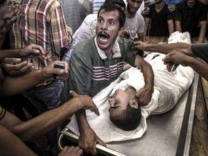 Israel under fire after 15 die at UN school
