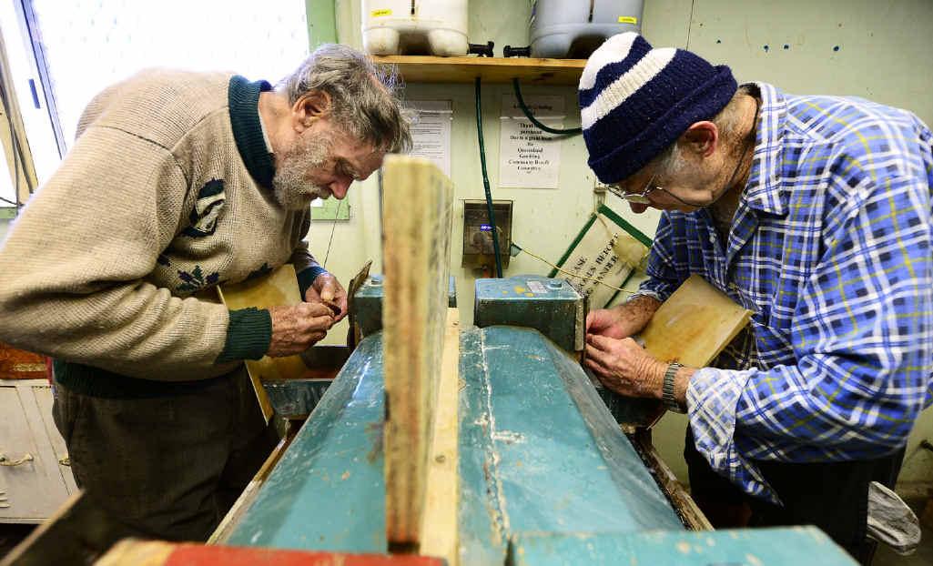 Helmer Lyster (left) and Edward Stone polish their gems.