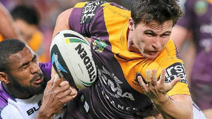 HANGING ON: Lachlan Maranta of the Broncos runs the ball against the Melbourne Storm at Suncorp Stadium last night.