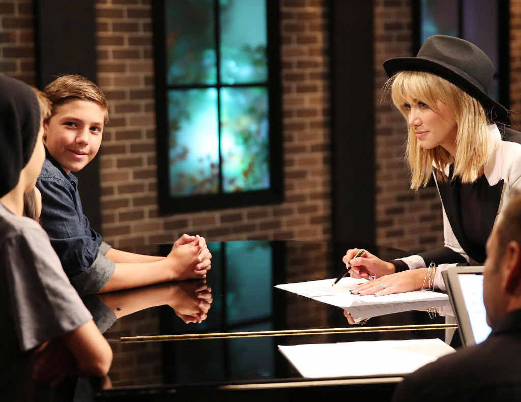 HIGH NOTE: The Voice Kids contestant Jamie, from Palmwoods, with his celebrity coach Delta Goodrem prepares for his three-way battle round.