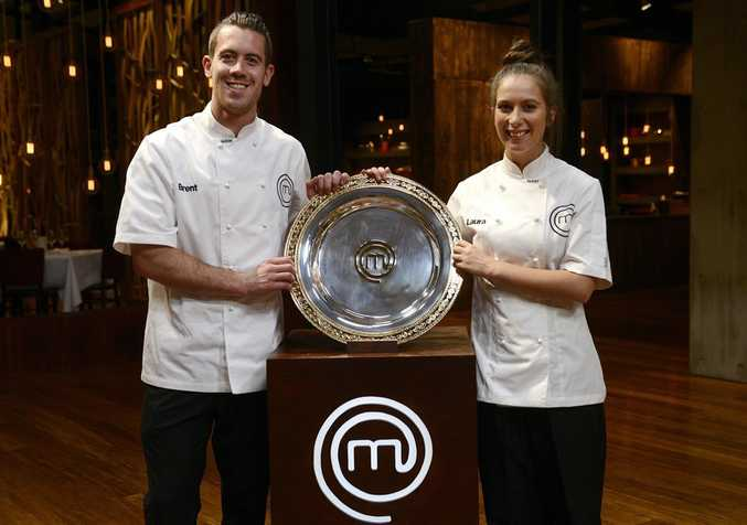 Brent Owens and Laura Cassai in their white aprons during their final cook-off in the MasterChef kitchen.