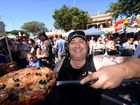 FESTIVAL FUN: Piping Hot Woodfired Pizzas owner Paul Somerfield at the Childers Multicultural Festival. Photo: Max Fleet / NewsMail