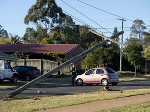 Power pole snapped in crash