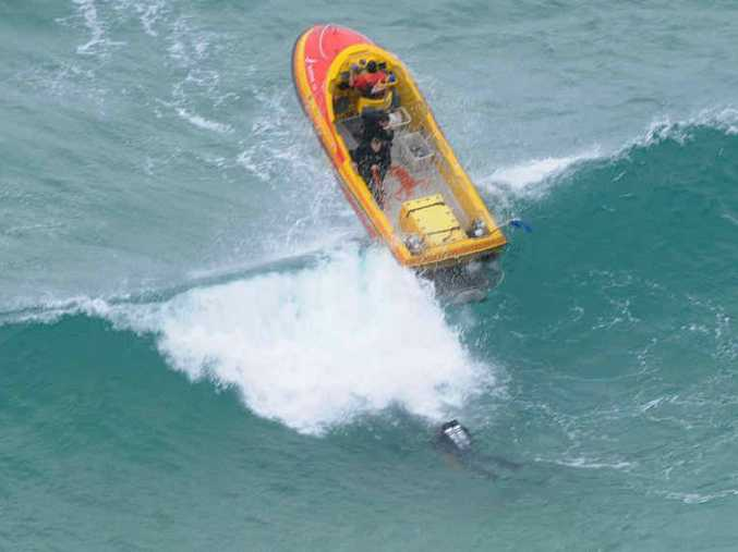 TOUGH JOB: Police divers search for missing Irish tourist Stuart Butler at Cape Byron on Saturday.