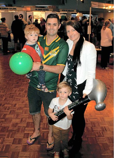 HAMMER TIME: Wollongbar's Kain and Chloe McGarry with sons Hudson, 3, and 11-month-old Oliver at the Ballina Home Sweet Home Expo on Saturday.