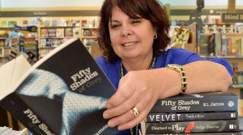 Karen Gampe of Collins Booksellers at Sydney St Markets with the erotica novel Fifty Shades of Grey.