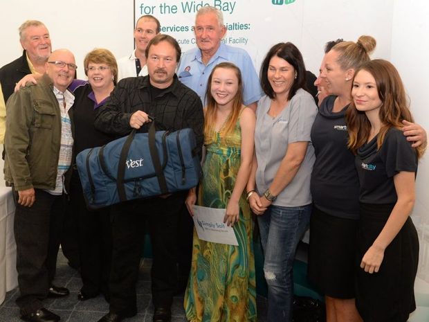 PERCUSSION VEST: Noel Gallagher, Billy Healy, Veronica Sussens, Matt Churchill, Vincent Zwarts, Jim Moodie, Sabrina Zwarts, Selena Pitt, Melissa Patterson and Sarah Martin at the presentation of the vest to cystic fibrosis sufferer Sabrina. Photo: Mike Knott / NewsMail