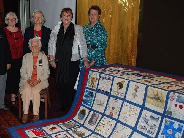 QUILT: L-R Judy Chappell, Bev Small, Pauline James- Deputy President and Recruitment Officer of the CCWA and Mavis Goodlad- Area Councillor for the RSL Women's Auxilliary. Seated is Nancy Farraway.