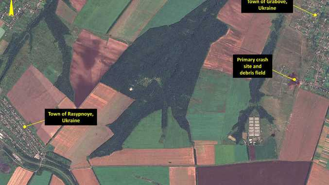 In this annotated photo, dated Sunday, July 20, 2014, provided by Airbus DS/AllSource Analysis, a satellite image shows the primary crash site, at top right, of Malaysia Airlines Flight 17 located near Hrabove, eastern Ukraine.