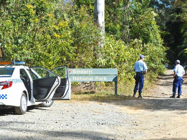 AT LARGE: Police set up a roadblock at the Entrance to Bindarri National Park near Dairyville as part of an operation to track down a wanted man. Photo: Rob Wright / Coffs Coast Advocate