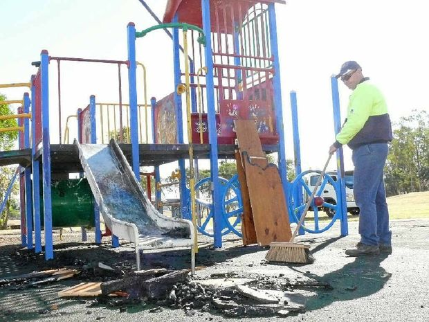 ACT OF STUPIDITY: Clarence Valley Council outdoor staff member Rob McLennan cleaning up the mess after vandals set fire to play equipment in Bob Liddiard Park, South Grafton on Sunday night. Photo Tim Howard