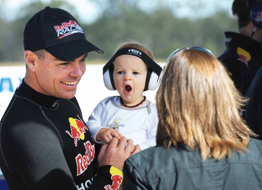 TIME OUT: Harrison Downes with V8 supercar driver Craig Lowndes during a break in testing at Queensland Raceway.