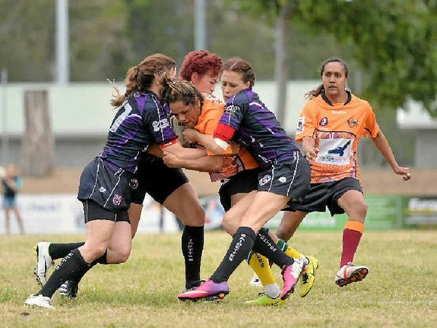 Amy Parry (left) and her fellow Raidettes, including Marlane Davies (right), were crunching in defence against the Cherbourg Hornettes on Saturday afternoon.