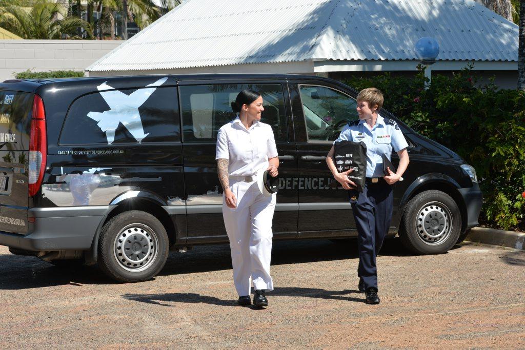 Leading Seaman Karen Dwyer, left and Squadron Leader Amanda Gosling arrive in Mackay. Photo Peter Holt / Daily Mercury