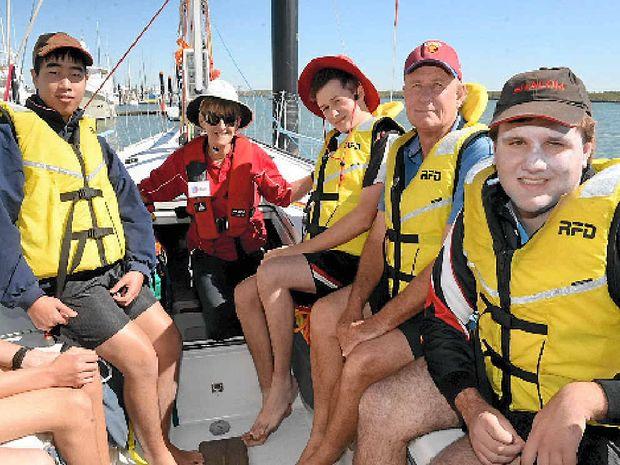 Nathan Chan, SWD volunteer Kristi Foster, Dylan Sanders, teachers assistant Grant Errington and Luke Bundesen on board the Sailors with Disabilities Yacht Kayle.