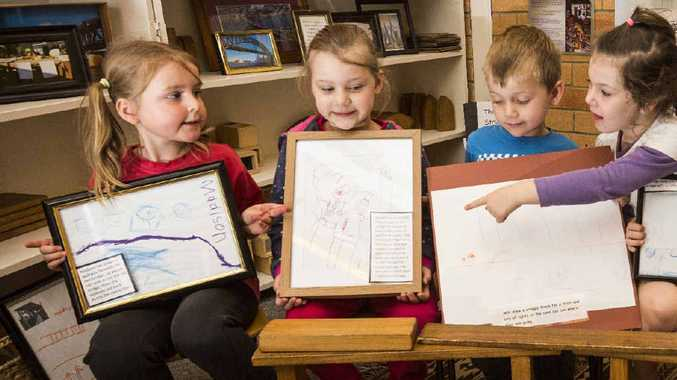 FULL OF IDEAS: Madison Durrington, Anabel Bridges-Hanson, Will Rhodes and Ashleigh Bulmer have a look at their designs for the new Grafton Bridge at Jack and Jill preschool.