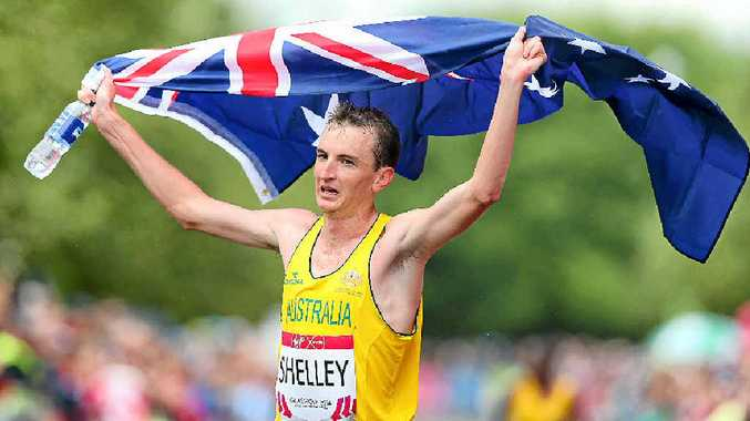 FLYING THE FLAG: Michael Shelley celebrates after winning the men's marathon in Glasgow. PHOTO: Alex Livesey/Getty Images