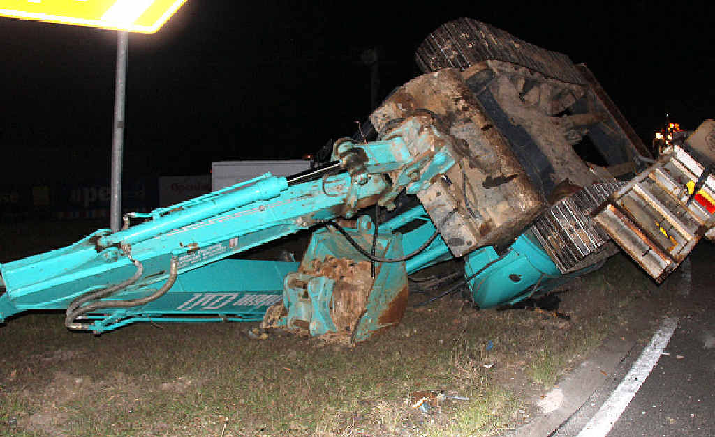 MANGLED: The scene of the excavator roll-over on the corner of the Bruce Hwy and Brisbane Rd.