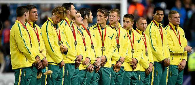 MEDAL REFLECTIONS: Former Ipswich rugby player James Stannard (third from right) receives his bronze medal as part of Austalia's Sevens team at the Commonwealth Games in Glasgow.