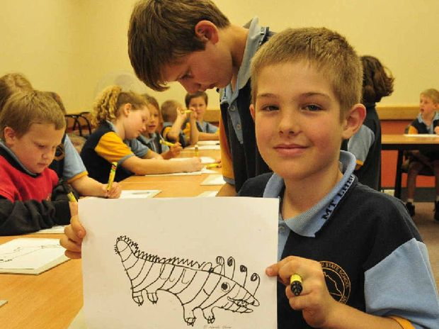 IT'S A THINGAMAJIG: Jon-Alan Smith, 8, from Mount Larcom State School with artwork he made at the Curtis Coast Literary Carnivale.