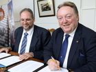 GREAT STEP: Rail Skills Australasia chair Tom Wiltshire and MP Glen Elmes sign a Memorandum of Understanding.
