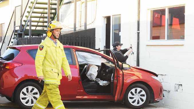 A fireman at the scene of a car crash at the Shamrock Hotel.