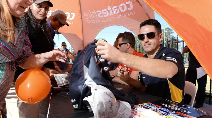 STRONG SUPPORT: Reigning V8 Supercars champion Jamie Whincup signs memorabilia for fans at yesterday's special appearance at Ipswich Coates Hire at Churchill. It's the fourth year Coates Hire have been naming-rights sponsor for this weekend's event at Queensland Raceway.