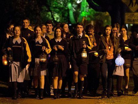 Toowoomba Catholic school students rally in Queens Park last night.