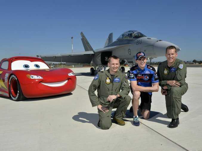 AT THE READY: V8 Supercars Championship leader Mark Winterbottom with Flight Lieutenant Robert Cousland and Flight Lieutenant Dave Murphy.