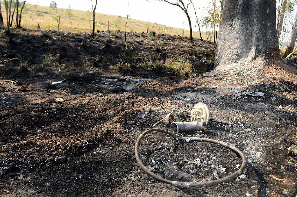 Burned earth and car parts at the site of the road tragedy.