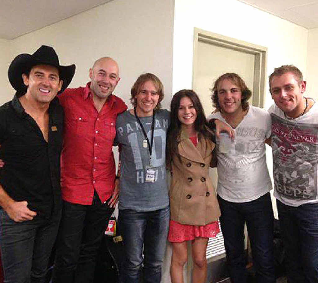 Caitlyn Shadbolt (centre) has rubbed shoulders with Australian country music legend Lee Kernaghan (far left). Kernaghan is tracking Caitlyn's progress on X Factor.