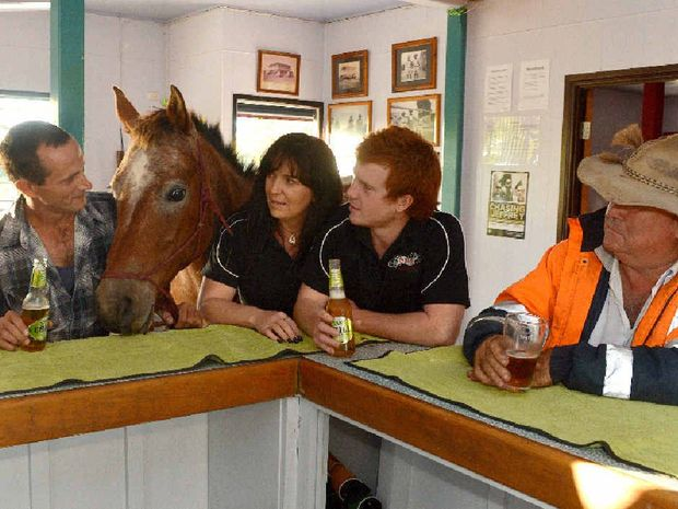 FAITHFUL STEED: Chris Parker, horse Bobbi J, publican Janessa Gilmont, Chris Gilmont and Col Johnson share an afternoon drink at The Old Hotel Eton.