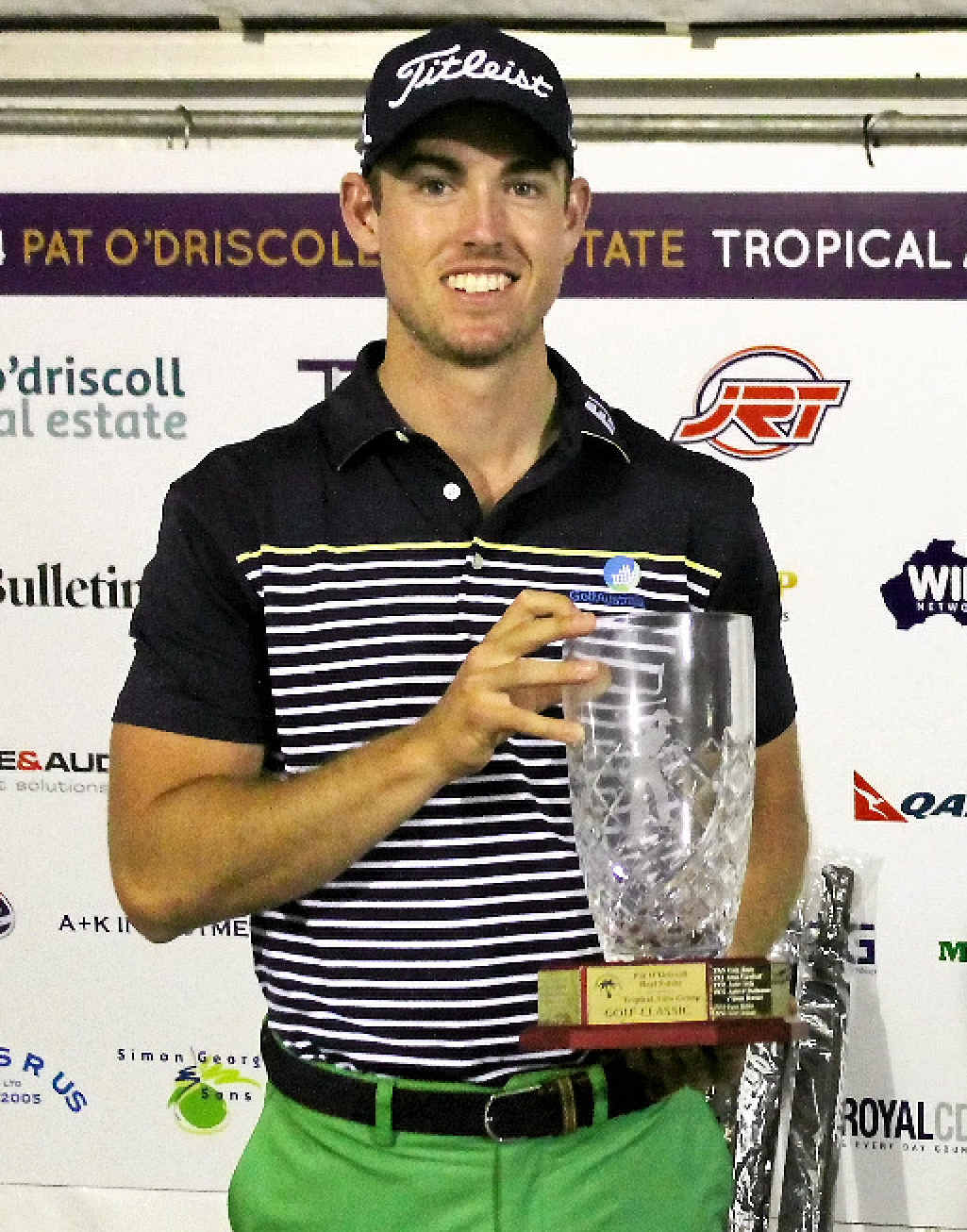 TROPHY TIME: Nathan Holman celebrates his one-shot victory in the annual pro-am classic at Yeppoon's Mercure Capricorn Resort.