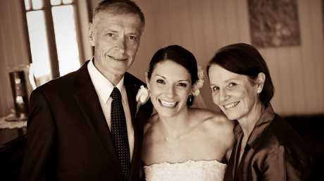 Roger and Jill Guard congratulate their daughter Amanda Koopman on her wedding day in 2010.