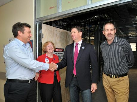 GLNG Gladstone Regional Manager Garry Scanlan, Gladstone Hospital director of medical services Dr Nicki Murdock, and QGC Vice President Sustainability Brett Smith show Queensland Health Minister Lawrence Springborg around QGC and Santos funded construction at Gladstone Hospital.