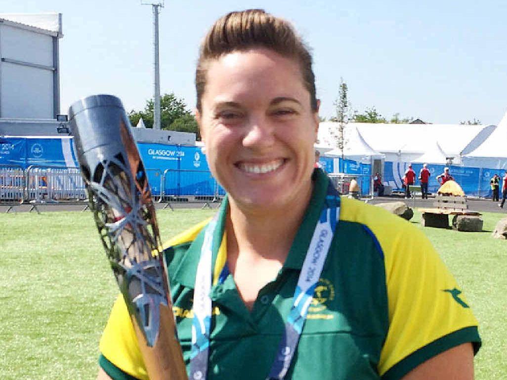 GLASGOW GLOW: Former Ipswich sportswoman Deborah Acason holds the Commonwealth Games torch during her record-breaking achievement.