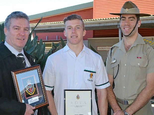 ADFA EDUCATION AWARD: Chancellor State College principal Glen Robinson, Year 12 student Timothy Sullivan and Captain Glenn Ellis.
