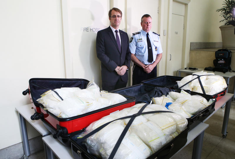 ACC National Manager of Investigations Richard Grant and AFP Commander Bruce Giles (on R) and with approximately 135 kilograms of crystal methylamphetamine that has been seized and four men have been arrested in Victoria, Wednesday, July 30, 2014.