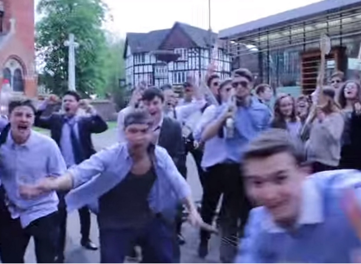 A scene from the video shows students mock rioting