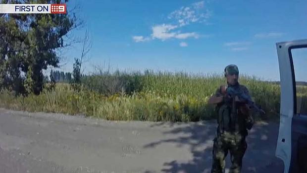A soldier who held veteran journalist Damian Ryan at gunpoint. Photo: Channel Nine