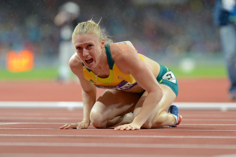 Australia's Sally Pearson reacts after winning the gold medal in the women's 100m hurdles at the athletics at the Olympic Stadium during the Olympic Games in London, Aug. 7, 2012.
